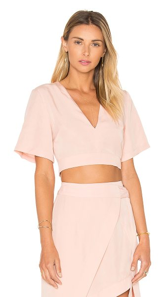 State of Being Layer Up Crop Top in blush - 100% lyocell. Hand wash cold. Back cut-out detail with...
