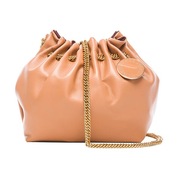 STELLA MCCARTNEY Noma bucket bag in neutrals - Eco alter nappa with faux suede lining and gold-tone...