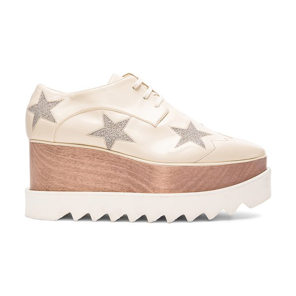 Stella McCartney Elyse Star Platform Shoes in ecru & osmium - Faux leather upper with bio-degradable sole. Made in...