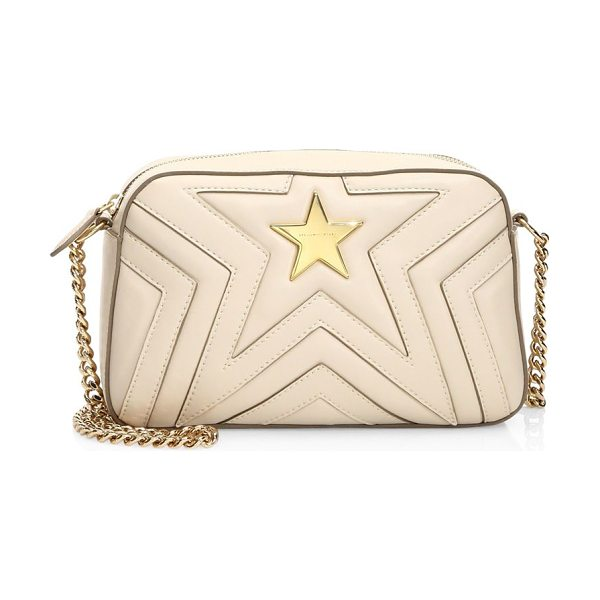 Stella McCartney faux leather star crossbody bag in cream - Mini star quilted crossbody bag with goldtone hardware....