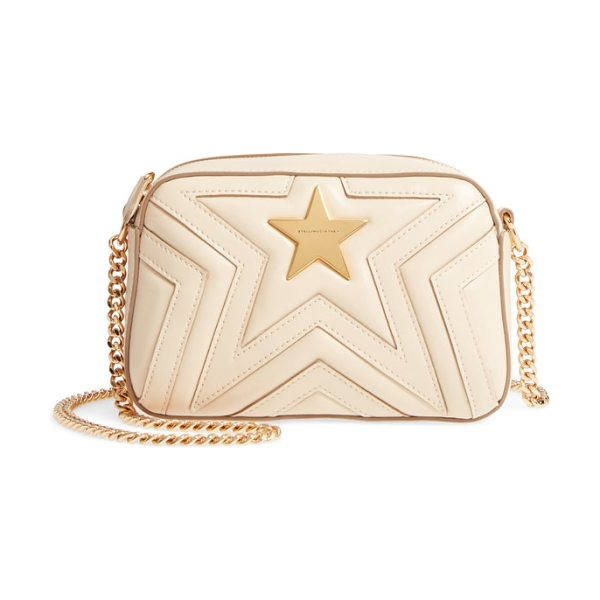 Stella McCartney mini star quilted faux leather camera bag in cream - Signature Stella McCartney stars are quilted right into...