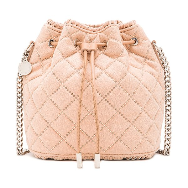Stella McCartney Studded quilted bucket bag in pink - Quilted shaggy deer fabric with signature print poly...