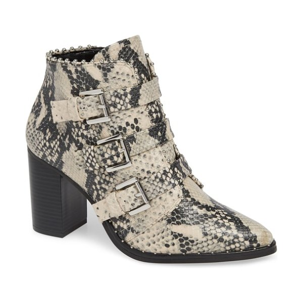 Steve Madden humble bootie in beige - Laddered straps and gleaming buckles add elegant edge to...