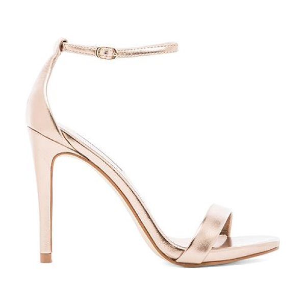 Steve Madden Stecy heel in metallic gold - Faux leather upper with man made sole. Heel measures...