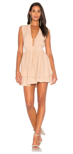 Stillwater Plunging Neck Mini in tan - 100% viscose. Dry clean only. Fully lined. Tiered hem....