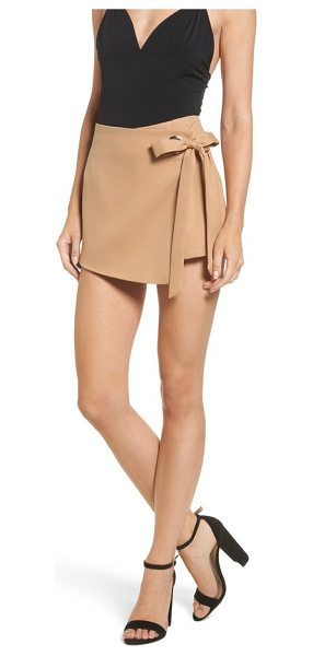 STOREE grommet mini skort in camel - An oversized tie and grommet hardware secure the...