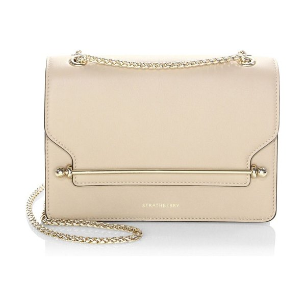 STRATHBERRY east/west leather crossbody bag in vanilla - Petite, chic flap closure clutch in quilted leather with...