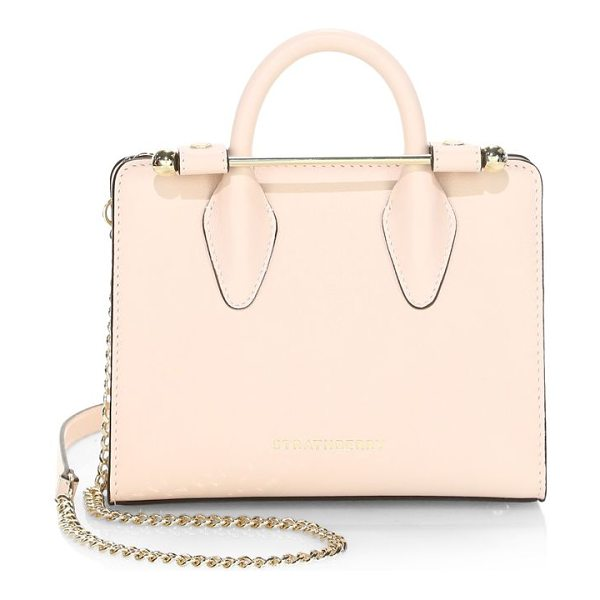 STRATHBERRY mini leather crossbody bag in nude - Structured mini tote with chain crossbody strap. Double...