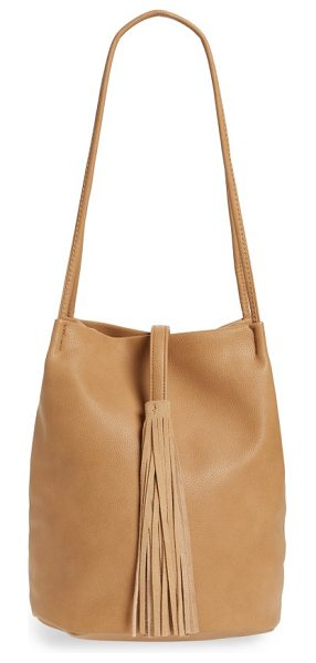 Street Level faux leather bucket bag in tan - A tassel embellishment adds a rustic flourish to a...