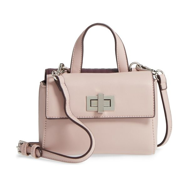 Street Level two-sided mini crossbody bag in burgundy/ blush - Two-faced becomes a compliment with a faux leather bag...