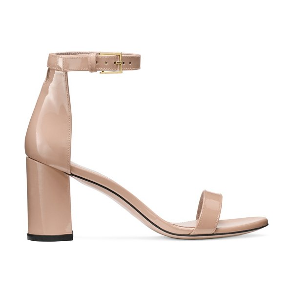 Stuart Weitzman 75Lessnudist in adobe beige patent leather - Defined by a rounded geometric heel, the 75LessNudist...