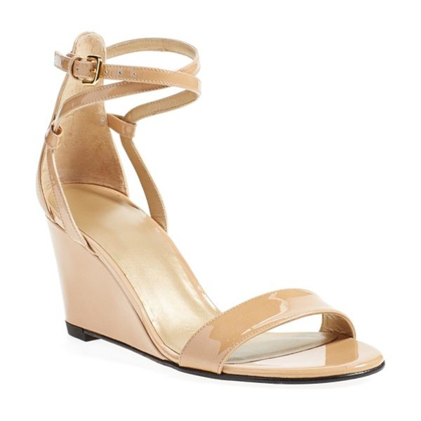 Stuart Weitzman backdraft ankle strap wedge sandal in adobe aniline - Glossy patent leather styles a sleek, wear-with-anything...