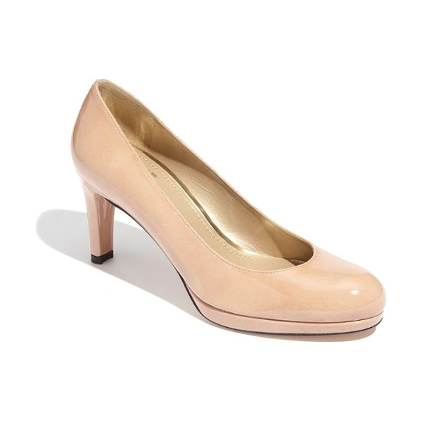 Stuart Weitzman blog platform pump in adobe aniline - A classic pump with an almond-shaped toe is elevated by...
