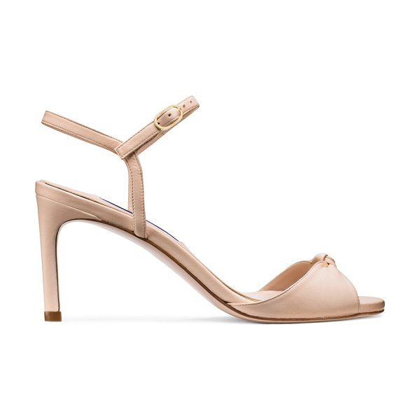 Stuart Weitzman Gloria 80 in adobe beige nappa leather - A knotted detail rendered in luxurious nappa sets the...