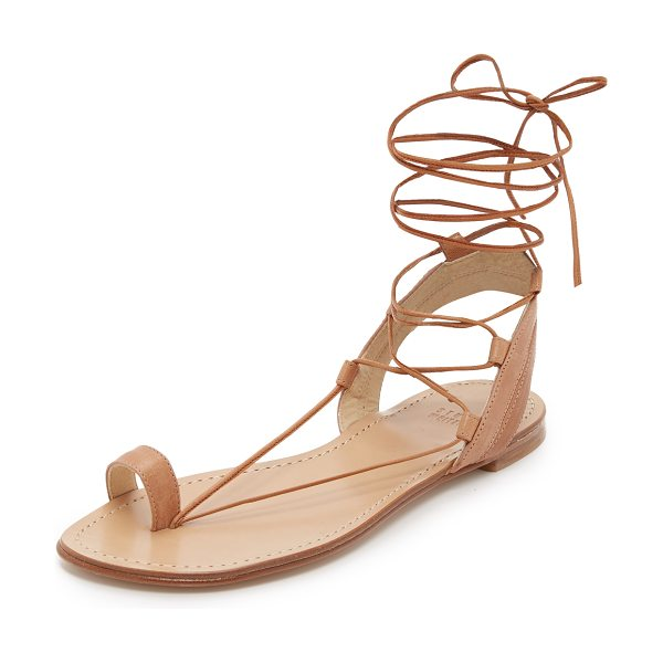 Stuart Weitzman Lasso flat sandals in camel - Smooth leather straps compose these toe ring Stuart...