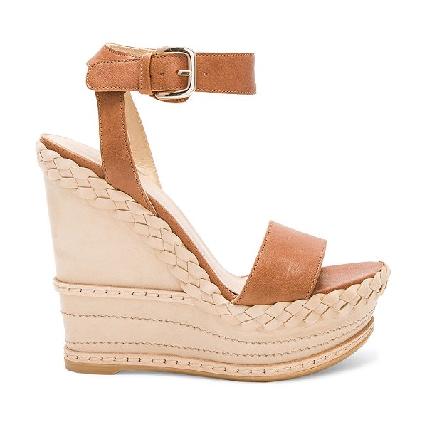 """Stuart Weitzman Lets Dance Wedge in brown - """"Leather upper with rubber sole. Ankle strap with buckle..."""