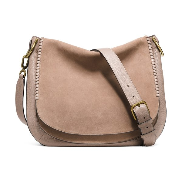 STUART WEITZMAN Lexie in haze beige suede - Equal parts streamlined and slouchy, this flap bag is...