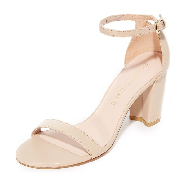 Stuart Weitzman nearlynude sandals in adobe - Slim straps compose these smooth leather Stuart Weitzman...