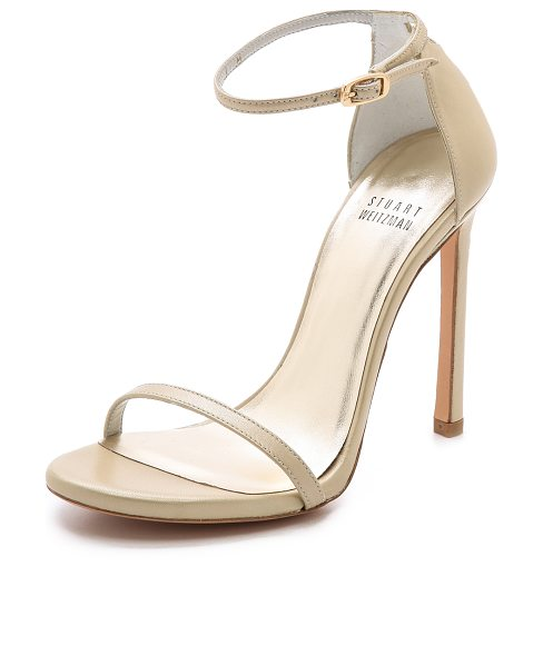 Stuart Weitzman Nudist single band sandals in pale gold - Slim straps lend a delicate feel to leather Stuart...