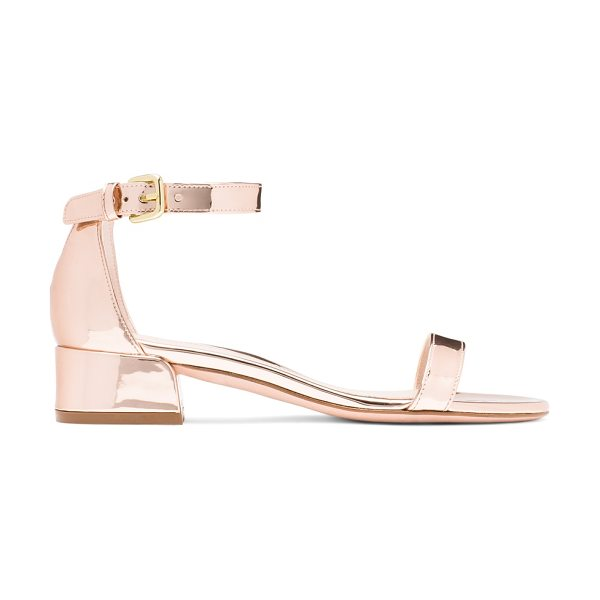 Stuart Weitzman Nudistjune in rose gold glass - Finished with a subtle block heel, the minimalist...