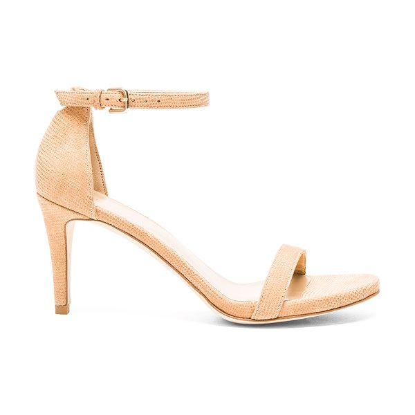 Stuart Weitzman Nunaked Heel in tan - Embossed suede upper with leather sole. Ankle strap with...