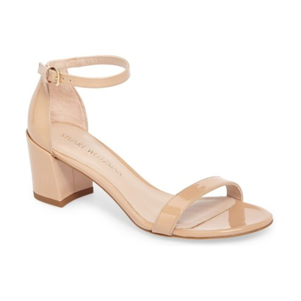 Stuart Weitzman simple ankle strap sandal in adobe aniline patent - A slim, demure ankle strap tops a sleek sandal set on a...