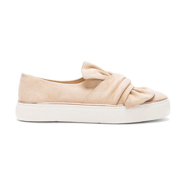 Stuart Weitzman Twisteze Sneaker in beige - Suede upper with rubber sole. Lace-up front. Bow accent...