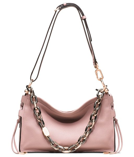 Stuart Weitzman Zoey in antique pink grain lux - Introducing the ZOEY, a chic, compact shoulder bag...