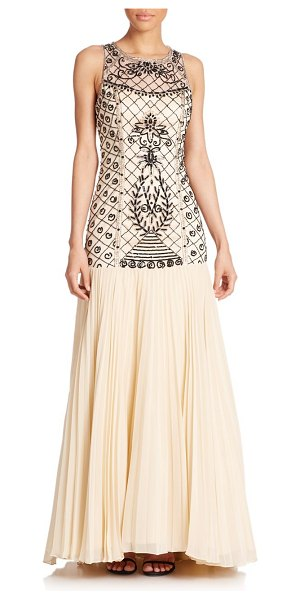 Sue Wong Beaded drop-waist gown in champagne - A lattice of rich, jet beaded and sequined embroidery is...