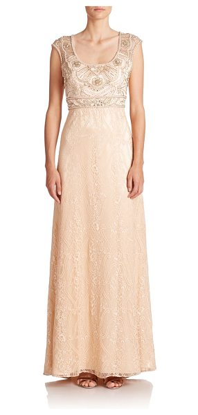 Sue Wong Embellished lace gown in champagne - An elegant lace gown accented with intricate beading at...