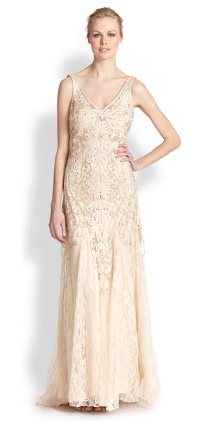 Sue Wong Embroidered v-neck chiffon gown in champagne - Allover metallic and soutache embroidery heighten the...