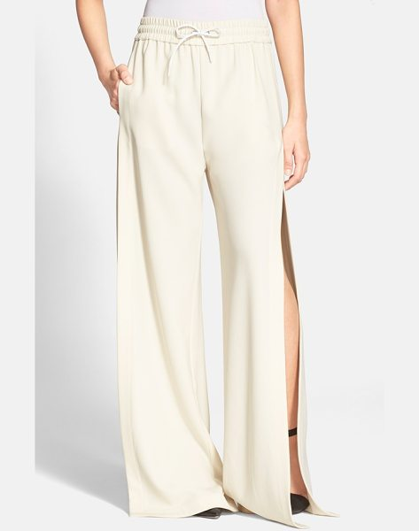 T by Alexander Wang side slit wide leg track pants in ecru - Sportswear and luxe street style combine on these...
