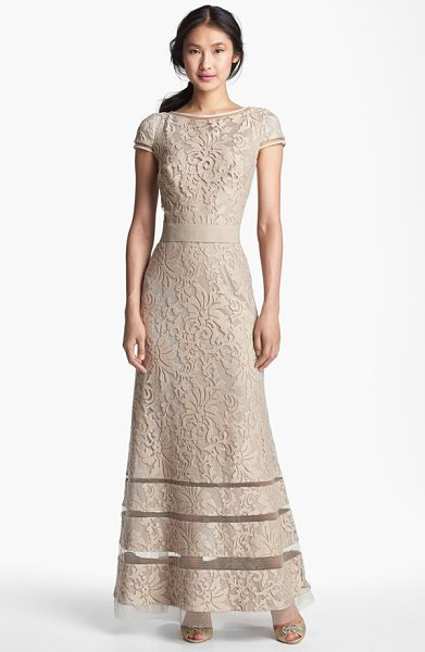 Tadashi Shoji cap sleeve lace gown in sand - Sheer insets encircling the high neckline, cap sleeves...