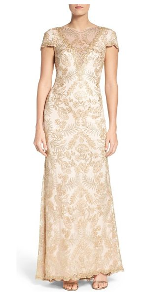 Tadashi Shoji embroidered gown in light gold/ primrose - Shimmery embroidery over wispy mesh flows with this...