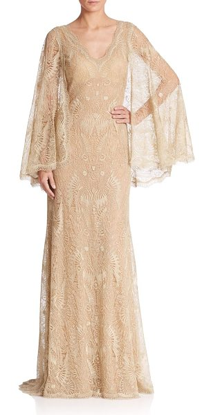 Tadashi Shoji Lace cape gown in gold - Ladylike lace takes a dramatic turn, thanks to a...