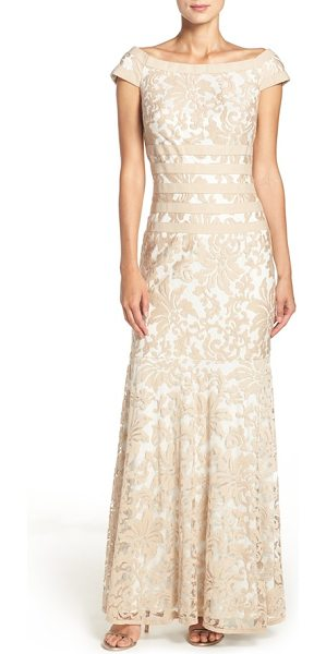 Tadashi Shoji textured lace mermaid gown in sand/ ivory - Elaborate, textured lace fashions a stately,...
