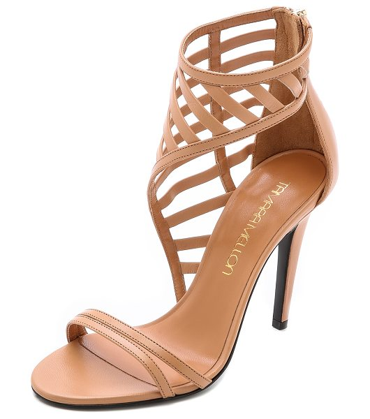 Tamara Mellon Jealous sandals in nude - Latticed, asymmetrical cuffs give these strappy leather...