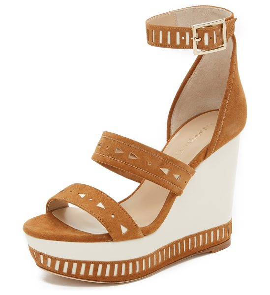 Tamara Mellon Zabriskie Suede Perforated Wedges in tan - Geometric perforations accent these smooth leather and...