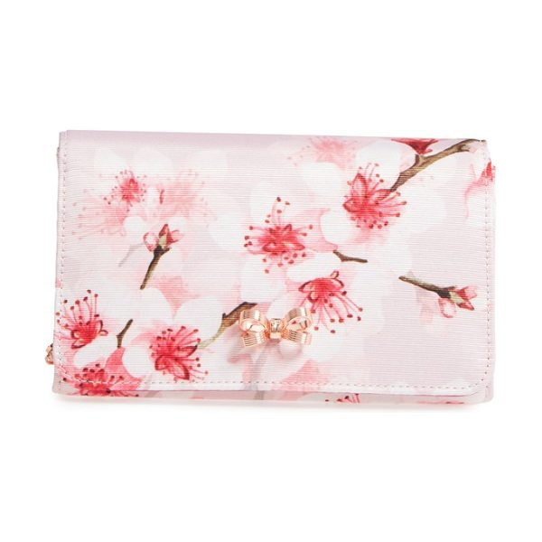 TED BAKER basina floral print clutch - A signature golden bow gleams against the pretty floral...