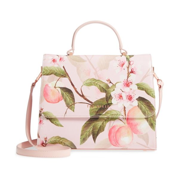 Ted Baker dipelta peach faux leather satchel in light pink - Lovely peach blossoms bloom across a structured,...