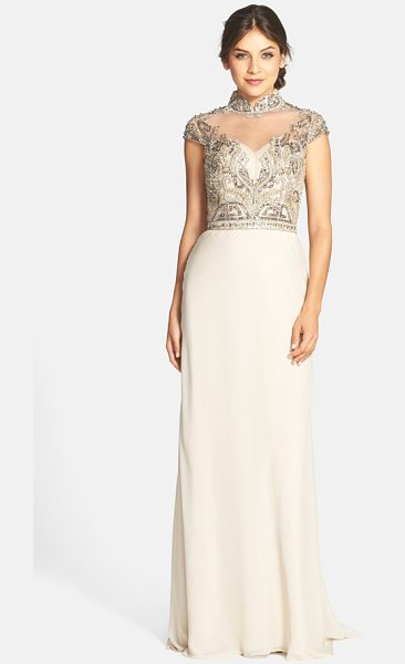 Terani Couture embellished high neck gown in champagne - Cap sleeves frame the elegant high neckline of a...