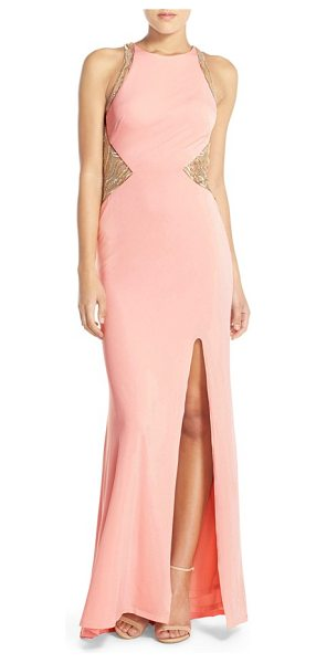 Terani Couture embellished illusion jersey gown in pink - A spectacular array of glittery embellishments encrusts...
