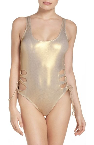 The Bikini Lab island in the fun mio one-piece swimsuit in gold - Sultry lacing and a metallic finish adds special detail...