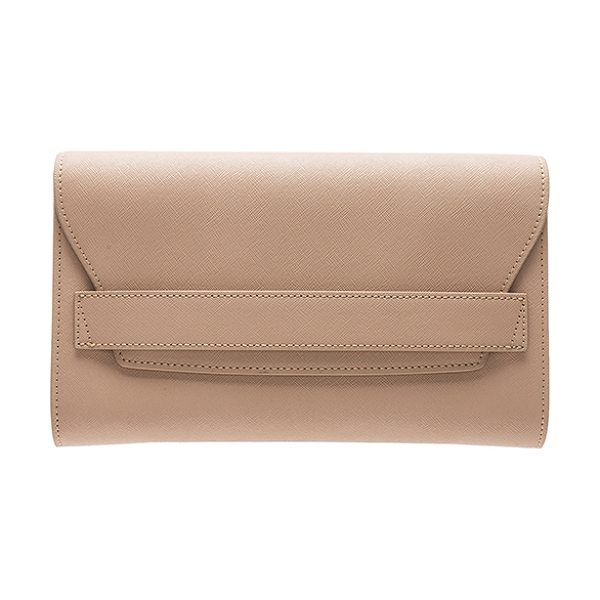 "the daily edited Fold Clutch in tan - ""Leather exterior with nylon fabric lining. Flap top..."