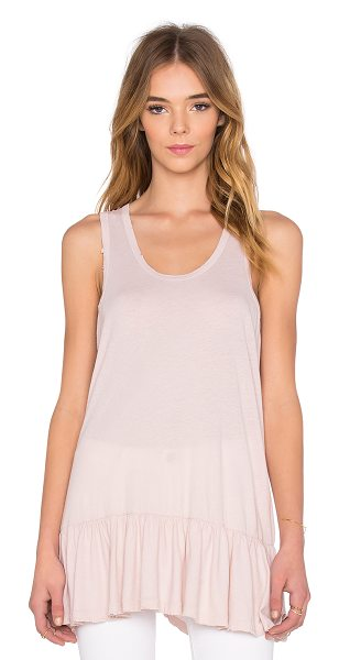 The Great Flounce Tank in pink - 100% cotton. Shirred drop waist. Distressed edges....