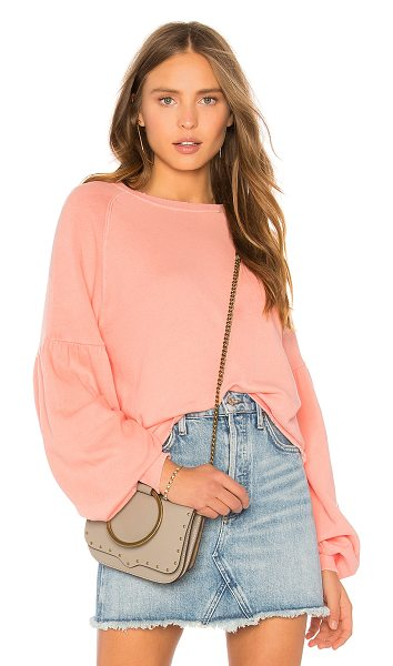The Great The Bishop Sleeve Sweatshirt in pink - 100% cotton. Intentionally distressed detail. Shirred...