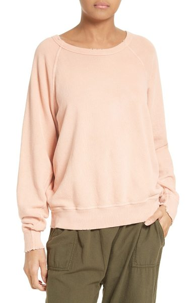 The Great the college french terry sweatshirt in coral - Subtle distressing around the rib-knit edge reinforces...