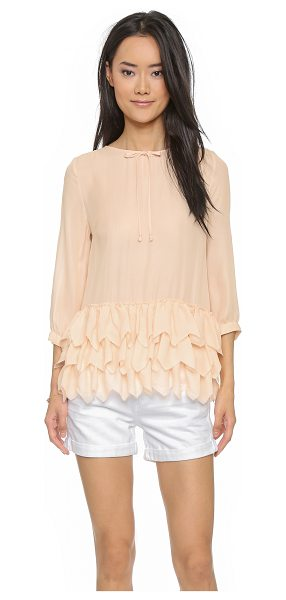 The Great The frill tunic in peach - A delicate THE GREAT. blouse with zigzag cut ruffles at...