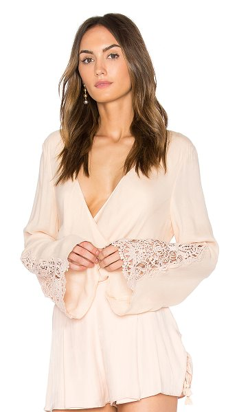 THE JETSET DIARIES Hyacinth Top - Rayon blend. Hand wash cold. Surplice neckline with hook...