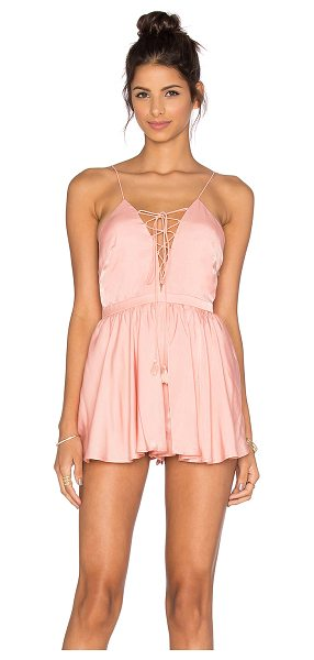 THE JETSET DIARIES Lotus Romper in blush - Rayon blend. Dry clean only. Lace-up front with tie...